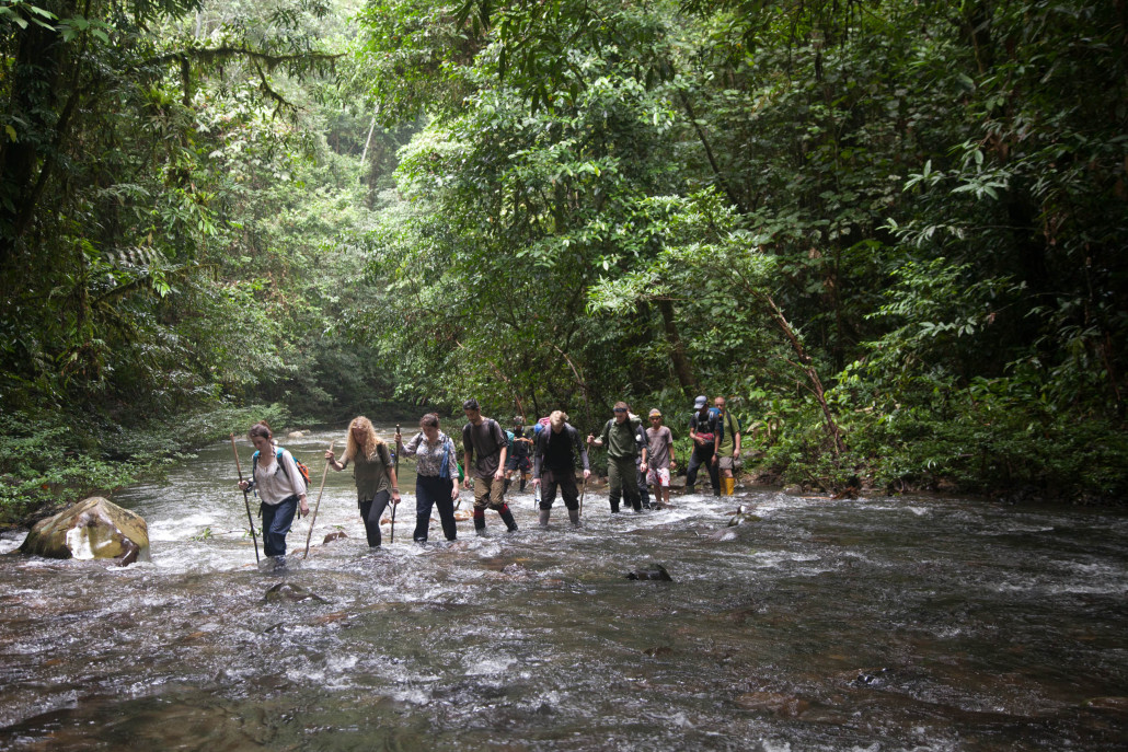 Students from the 2015 field trip crossing a river en route to their camp.